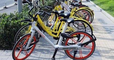 街头停放仍显杂乱 191万辆共享单车往哪儿停?