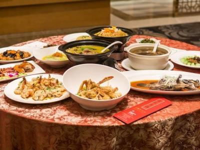 年夜饭预订旺,商家鼓励消费者自提回家吃